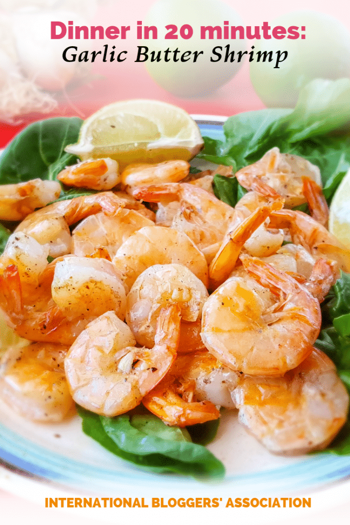 "plate of tail on shrimp with text overlay ""Dinner in 20 minutes: Garlic Butter Shrimp."""