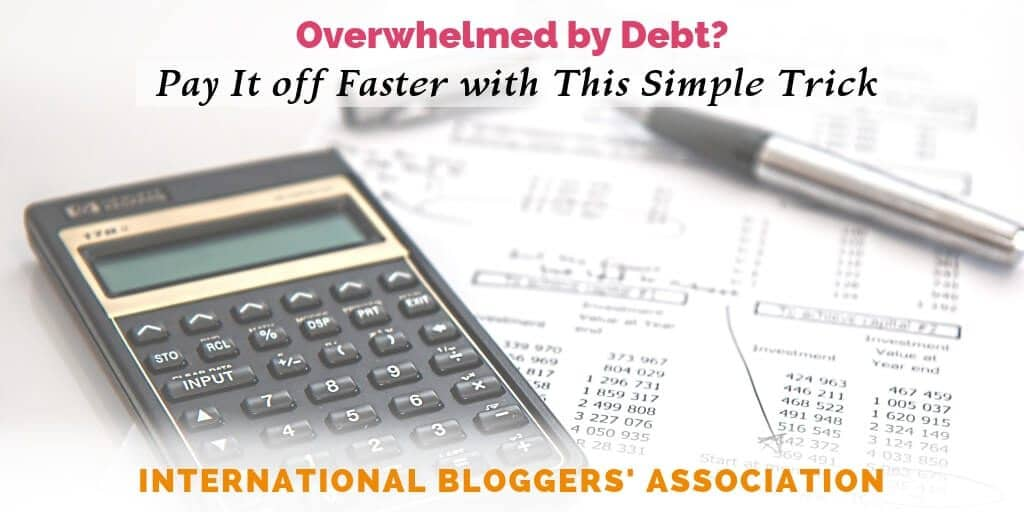 "calculator and debt sheet with text overlay ""Overwhelmed by Debt? Pay it Off with This Simple Trick"""