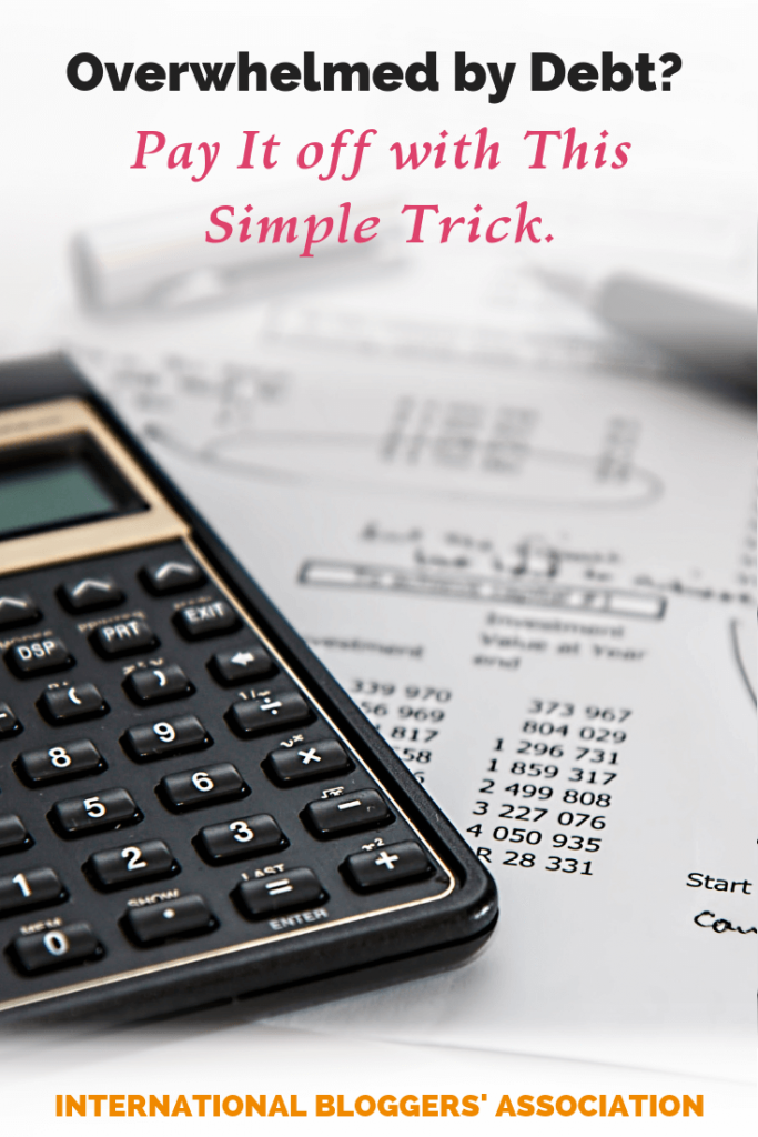 """calculator and debt sheet with text overlay """"Overwhelmed by Debt? Pay it Off with This Simple Trick"""""""