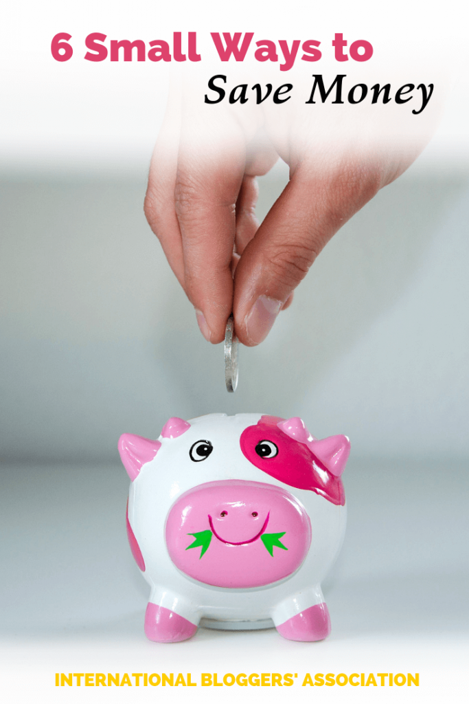 "hand dropping coin in piggy bank with text overlay ""6 small ways to save money"""