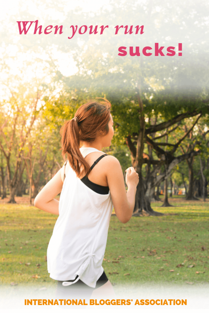 "woman running in a park with text overlay ""When Your Run Sucks"""