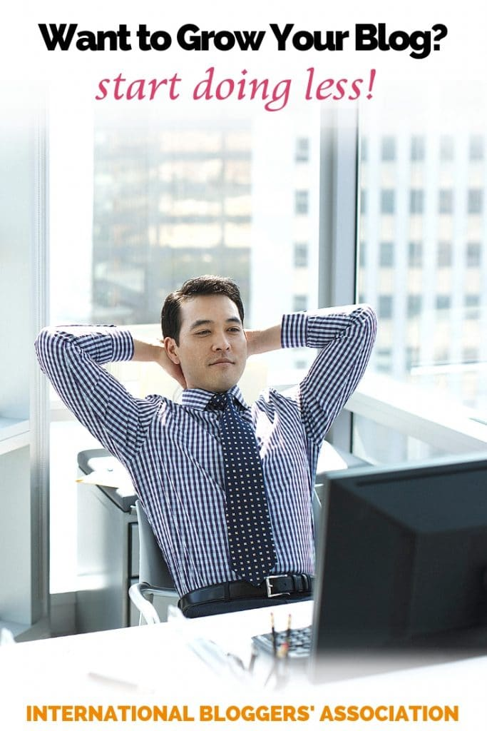 "man relaxing in front of a computer with text overlay ""Want to grow your blog? start doing less"""